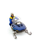 Homme conduisant le snowmobile Image stock