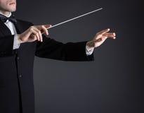 Homme conduisant un orchestre Photo stock