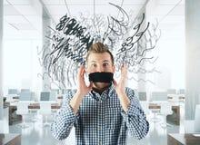 Homme confus avec la bouche attachée Photographie stock libre de droits