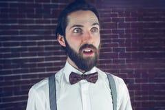 Homme confus regardant loin Photos stock