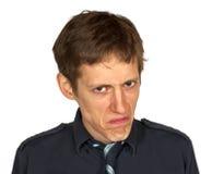 Homme contrarié sur le blanc Image stock
