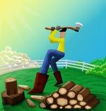 Homme coupant le bois Image libre de droits