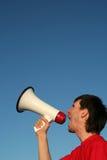 Homme criant par le mégaphone Image libre de droits