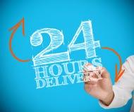 Homme d'affaires écrivant 24 heures de livraison Photographie stock