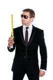 Homme d'affaires élégant dans des lunettes de soleil avec le ruban métrique d'isolement en fonction Images stock
