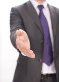 Homme d'affaires étendant la main ouverte à la secousse Photos stock