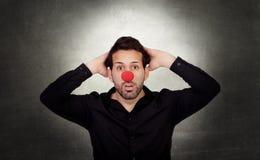 Homme d'affaires étonné avec le nez de clown Photographie stock