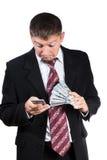 Homme d'affaires étonné avec le smartphone et l'argent images libres de droits
