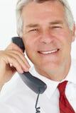 Homme d'affaires aîné au téléphone Image stock