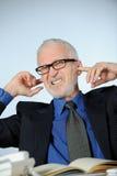 Homme d'affaires aîné fâché Photo stock