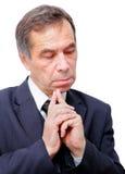 Homme d'affaires aîné pensant intéressé Photographie stock libre de droits