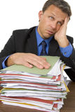 Homme d'affaires accablé par Paperwork Photos stock