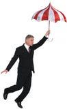 Homme d'affaires, affaires, parapluie volant d'isolement Photos stock