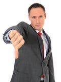 Homme d'affaires affichant des pouces vers le bas Image stock