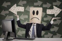 Homme d'affaires anonyme obtenant confus photos libres de droits