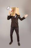 Homme d'affaires anonyme tenant un mégaphone image libre de droits