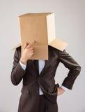 Homme d'affaires anonyme touchant son menton images libres de droits