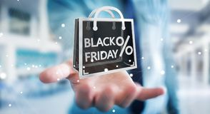 Homme d'affaires appréciant le rendu noir des ventes 3D de vendredi Photos stock