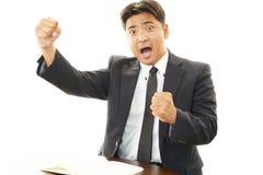 Homme d'affaires appréciant le succès Photo libre de droits
