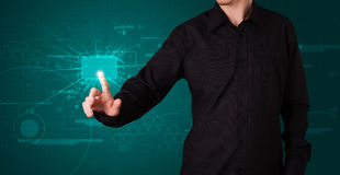 Homme d'affaires appuyant le type de pointe de boutons modernes Photos libres de droits