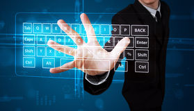 Homme d'affaires appuyant le type virtuel de clavier Photos stock
