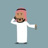 Homme d'affaires Arabe parlant au téléphone portable illustration libre de droits