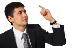 Homme d'affaires asiatique avec le doigt augmenté photos libres de droits