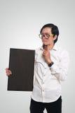 Homme d'affaires asiatique Holding Blackboard photographie stock