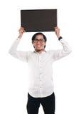 Homme d'affaires asiatique Holding Blackboard photographie stock libre de droits