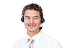 Homme d'affaires attirant avec l'écouteur en fonction photos stock