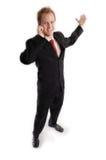 Homme d'affaires attirant dans le procès foncé Photo libre de droits