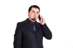 Homme d'affaires au téléphone sérieux Image stock