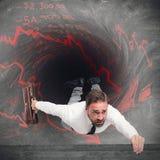 Homme d'affaires avalé par des dettes photo stock