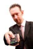 Homme d'affaires avec à télécommande Image stock