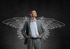 Homme d'affaires avec des ailes Photographie stock libre de droits