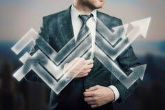 Homme d'affaires avec des flèches Images libres de droits