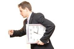 homme d'affaires avec des horloges Photos stock