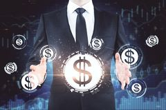 Homme d'affaires avec des icônes du dollar photographie stock libre de droits