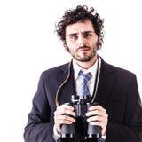 Homme d'affaires avec des jumelles Image stock