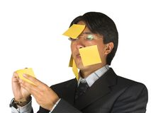 Homme d'affaires avec des notes de post-it Image libre de droits