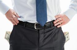 Homme d'affaires avec des poches pleines des dollars Photo libre de droits