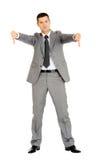 Homme d'affaires avec des pouces vers le bas Images libres de droits