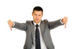 Homme d'affaires avec des pouces vers le bas Images stock
