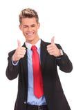 Homme d'affaires avec des pouces vers le haut de geste en bon état Image libre de droits