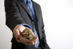Homme d'affaires avec du petit argent Image stock