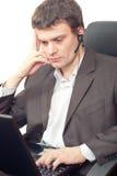 Homme d'affaires avec l'écouteur. Photographie stock