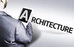 Homme d'affaires avec l'architecture des textes dans une image de concept image stock