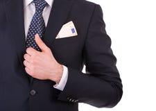 Homme d'affaires avec l'argent dans la poche de costume. Photos libres de droits