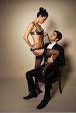 Homme d'affaires avec l'escorte sexy Image stock
