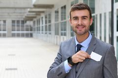 Homme d'affaires avec l'espace blanc de copie dans son étiquette de nom photo stock